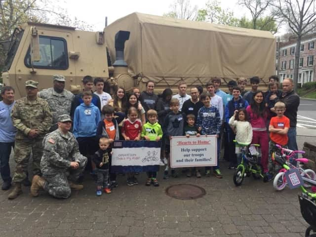 """Bronxville School students presented the children of deployed soldiers with new bicycles and helmets as part of the program """"Operation That's My Ride."""""""