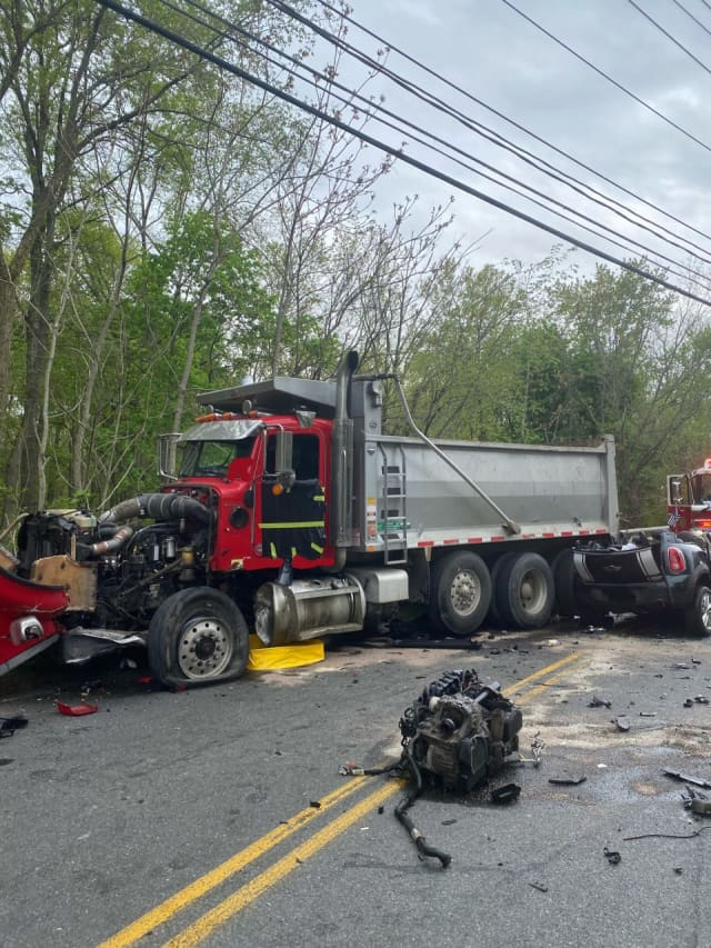Several roads are closed in West Nyack following a crash between a car and a dump truck.