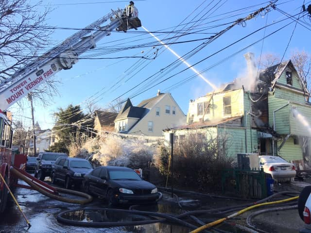 Fire crews in Mount Vernon spent hours knocking down the flames of a house fire on 13th Street.