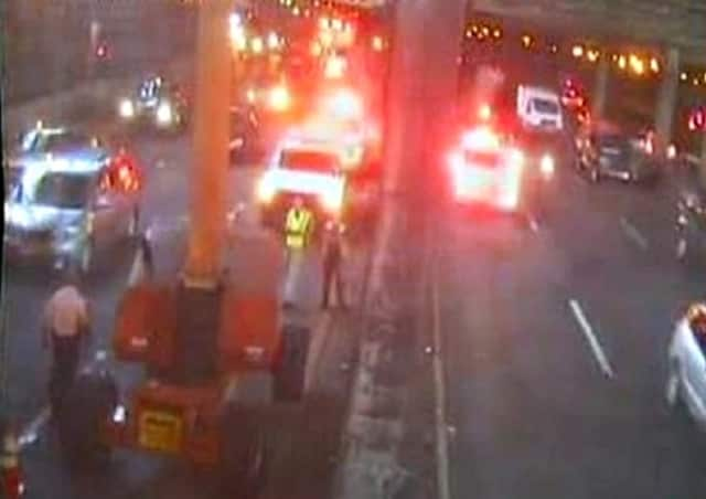 Emergency crew at work under the bus station on the Cross-Bronx Expressway at the GWB.