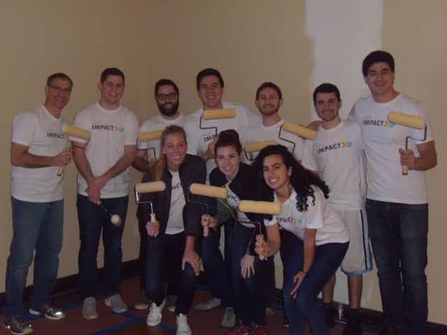 More than 20 Insight employees joined teens at St. Christopher's in Dobbs Ferry on Tuesday to help repaint and restore sections of the century-old campus.