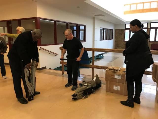 Rockland County DSS staff and Helping Hands officials work together to set up cots at the Warming Center.