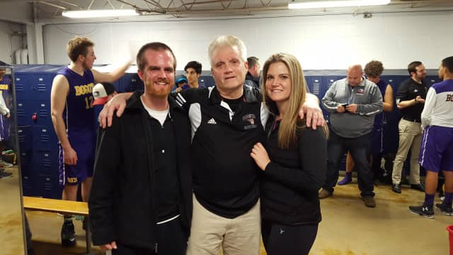 Jay Mahoney with his son and daughter after winning his 600th game Feb. 2.