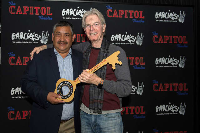 Phil Lesh receives the key to the Village of Port Chester from Port Chester Deputy Mayor Luis Marino.