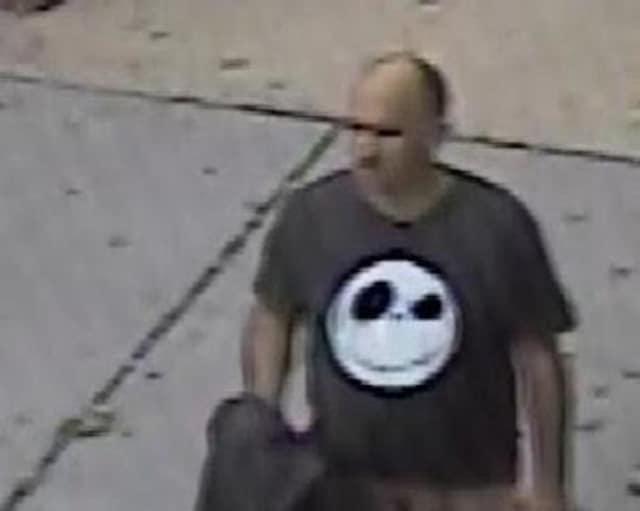 A surveillance photo of Officer Adam Fridson.