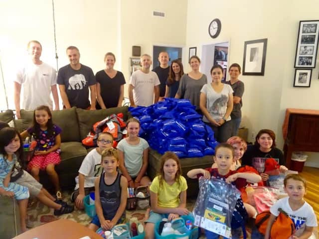 The Basbagill, France, Fero, Estrada, Jasgur, Record, and Tucciarone families, all members of IMPACTrumbull, recently assembled 310 Blessings Bags, 45 Care Caddies, 70 backpacks, and 60 school supplies kits.