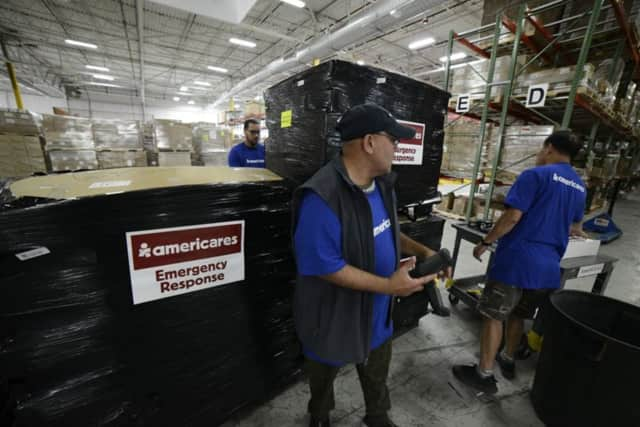 Workers at the U.S. distribution center for Americares prepare to send medicine and relief supplies to Haiti after Hurricane Matthew ravaged the area.