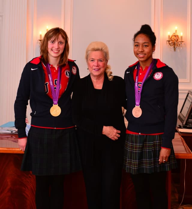 Sacred Heart Greenwich Head of School Pamela Juan Hayes, with Olympic swimmers Katie Ledecky and Lia Neal, who both attended Sacred Heart schools.