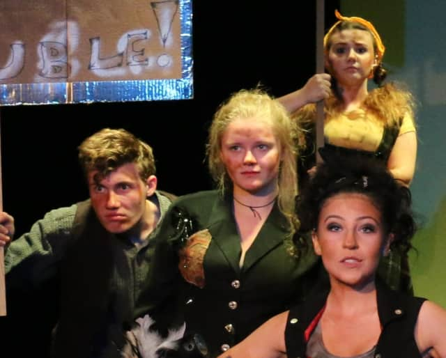 "a scene from ""Urinetown"""