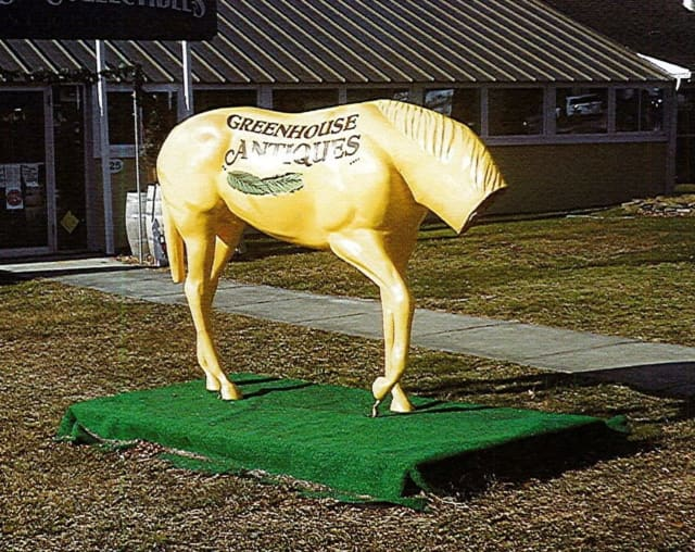 Police in Suffolk County are attempting to locate the people who broke a horse statue in St. James.