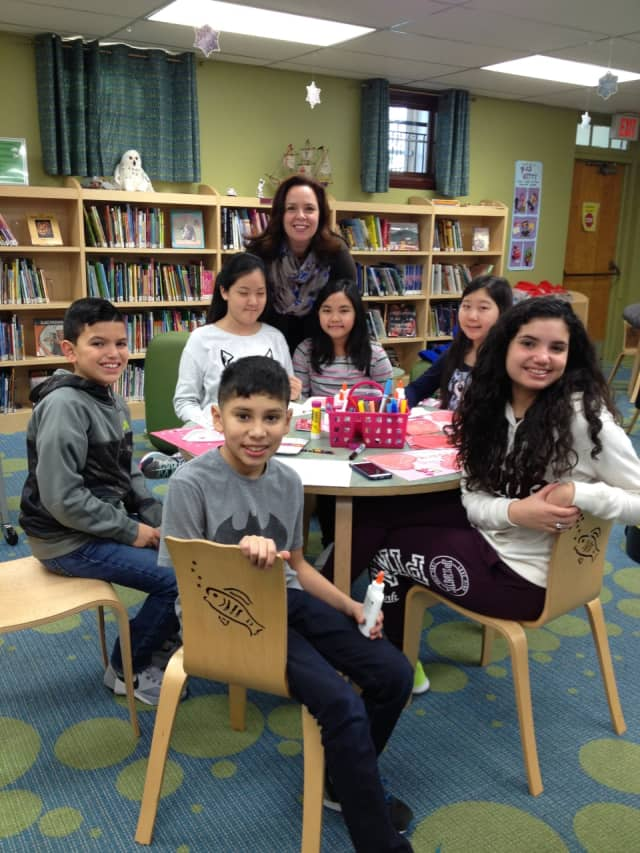 Children's Librarian Maria Russo with some kids at the East Rutherford Memorial Library.