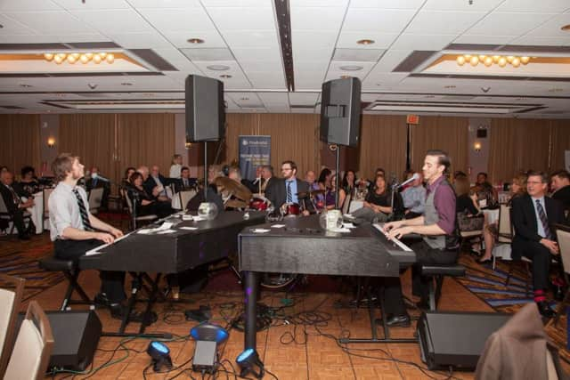 Dueling pianos at Valley United Way's 2015 community gala. United Way will give nearly $40,000 in grants for special needs and programs to Valley agencies.