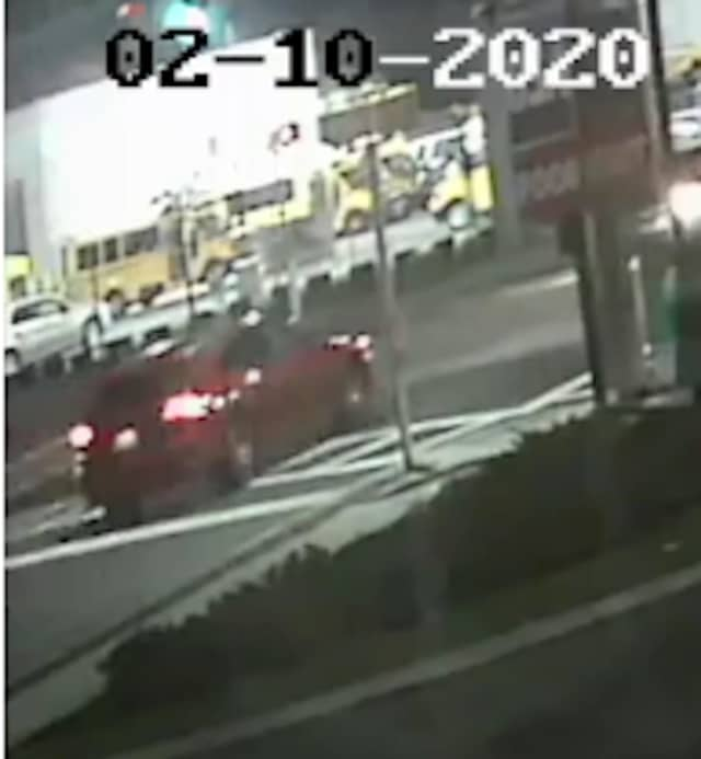 A photo of the red SUV (shown above) released by police prior to the arrest.