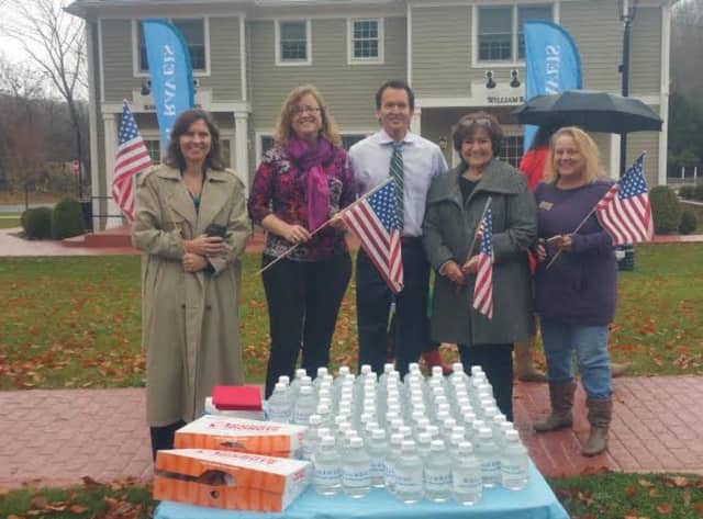 William Raveis Real Estate agents recently joined in saluting military veterans in Somers.