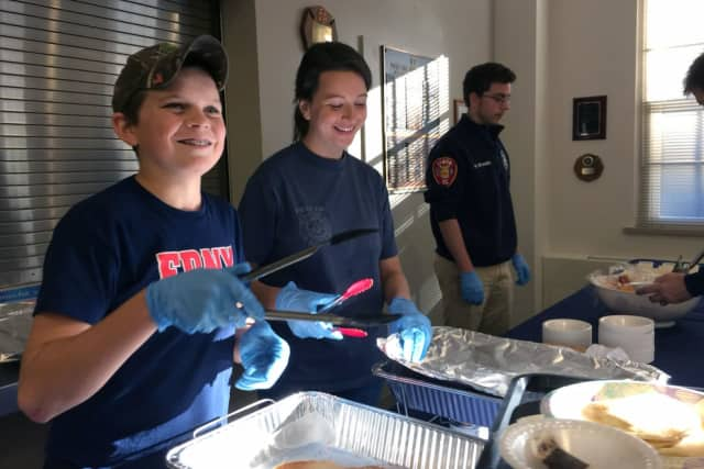 Ethan Haberny and Kim Malizia, pictured serving pancakes at the Vista Fire Department's pancake breakfast, which was held on Saturday, Oct. 15.