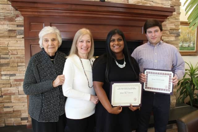 Putnam Hospital Center Auxiliary Co-President Rose McQuade, from left, and hospital Director of Volunteer and Pastoral Services Michelle Piazza, present scholarship awards to North Salem High School seniors Anna Mattamana and Sean Leuschner.