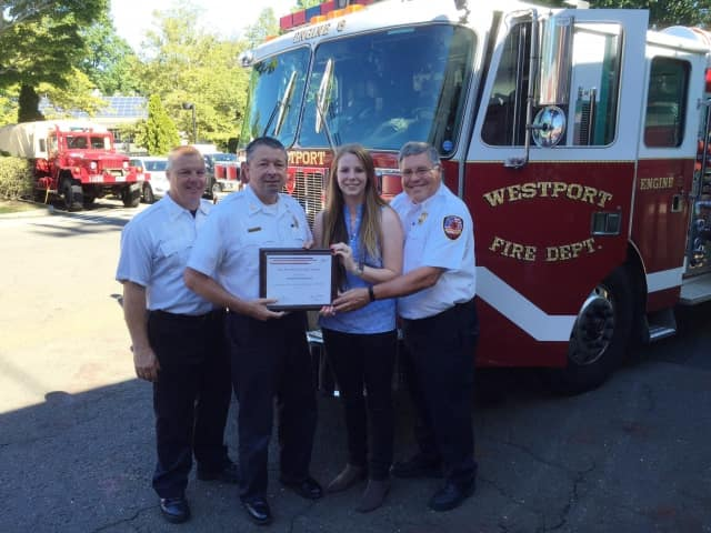 FM Global representative Meaghan Paul presented the award to Westport Fire Department Chief Andrew Kingsbury, Assistant Chief John Plofkin Jr., and Deputy Chief Robert Kepchar at fire headquarters Friday.