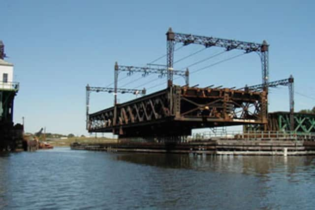 The Walk Bridge, which carries four train tracks for Metro-North and Amtrak, swings open to allow marine traffic to move through Norwalk Harbor.