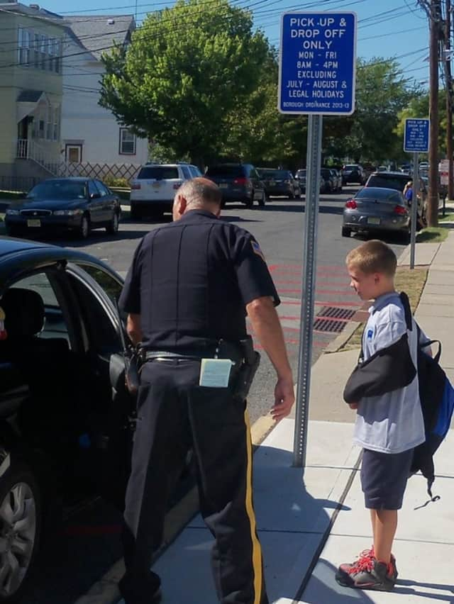 Wallington Police Officer Gerald LaVacca helps a youngster.