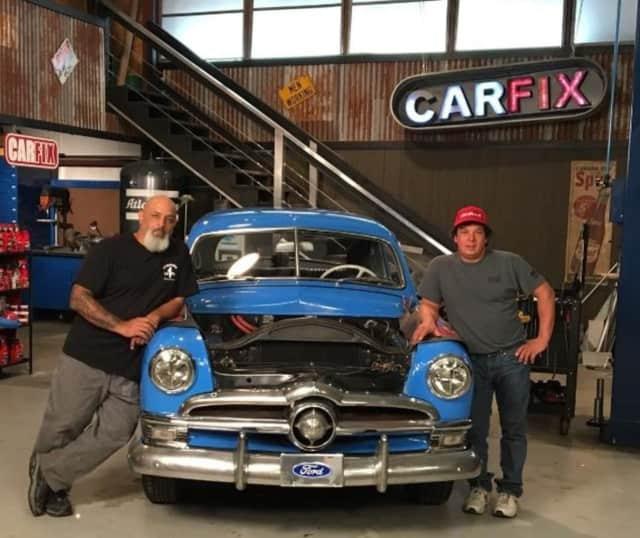 "Chuck Wanamaker III, right, with his 1950 Ford Coupe, and co-host Lou Santiago on the set of ""Car Fix"" in Florida."