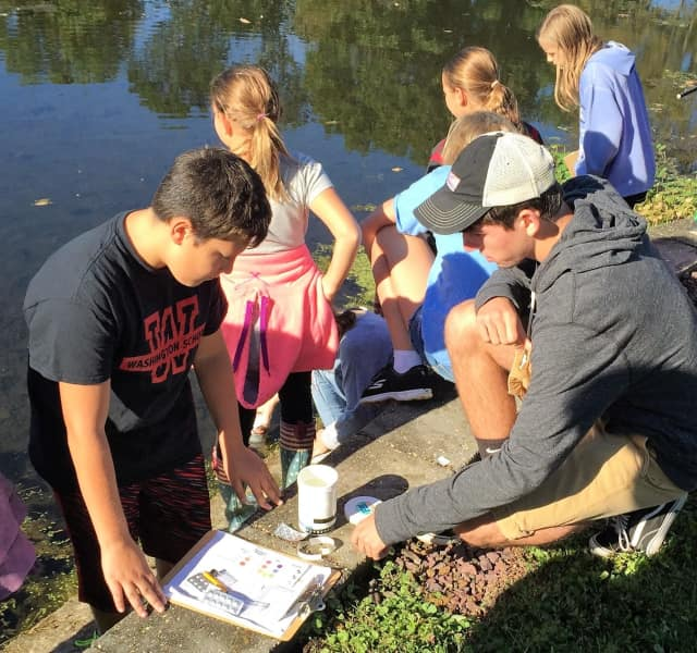 Students conducting water-quality tests on Schlegel Lake.