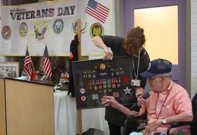 Waveny Village resident and decorated veteran Anthony Moody shared his personal account of the Battle of the Bulge in World War II for a Veterans Day event this week.