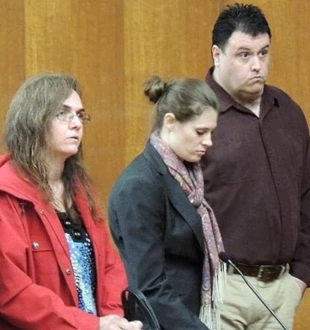 Karl Weckstrom, defense attorney J.M. Doyle, Michelle Weckstrom in court in 2014.