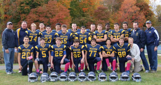 The Weston Trojans 8th grade football team defeated New Canaan, 8-7, in its final regular season game on Saturday.