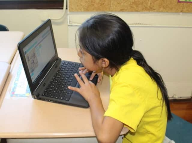 """Students from three local elementary schools recently took part in the """"Hour of Code"""" that teaches students how to code. This student works at Washington Irving Elementary School."""