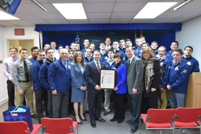 Westcheser County Executive Rob Astorino, center, congratuates his alma mater, Westlake High School in Mount Pleasant, for winning the football championship this fall. He is shown with members of the Wildcats football team.