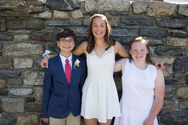 Harry Amadeo, Anna Imrie and Emma Delattre of Wilton recently graduated from Ridgefield Academy.