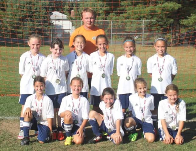 The Wilton U9 girls soccer team went undefeated in a Labor Day Tournament in Farmington. See story for IDs.