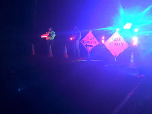 Members of Wilton CERT direct traffic late Monday night along Route 7 after a fallen tree blocked the road.