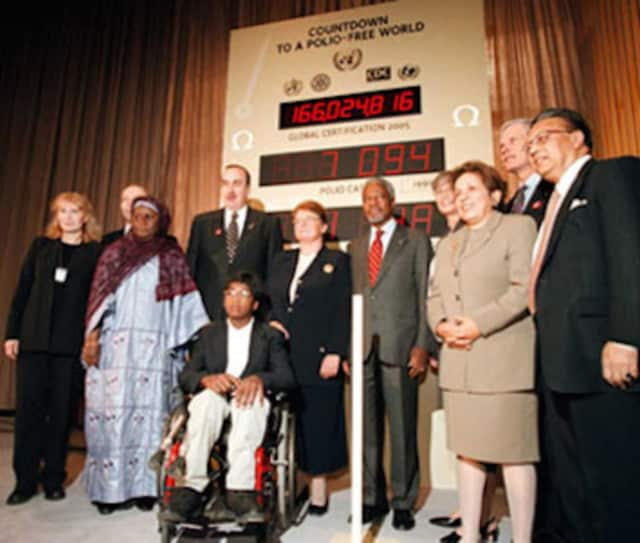 Thaddeus Farrow, in front in wheelchair, appears with then-UN Secretary-General Kofi Annan and other officials at a Polio Partners Summit in 2000 for UNICEF.