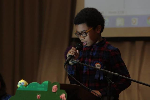 Woodside Elementary students recently participated in the 1st Annual Multilingual Poetry Café .