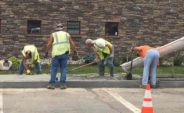 A new sidewalk was installed earlier this month at the Haworth Municipal Library.