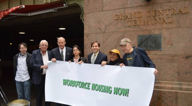 Community Housing Innovations's executive director Alexander Roberts, fifth from left, stands with other members of the Westchester Workforce Housing Coalition, including Dennis Hanratty, executive director of Mount Vernon United Tenants, far right.