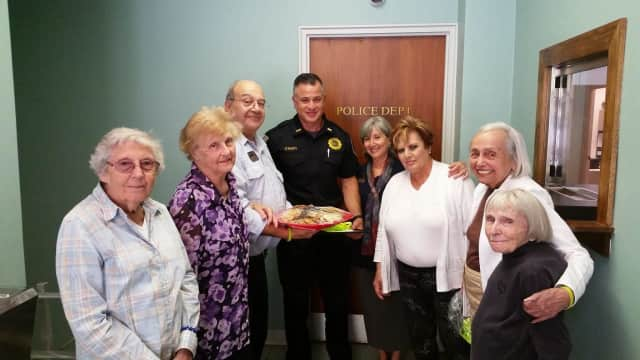 Seniors at Atria show their appreciation to the Briarcliff Police Department.