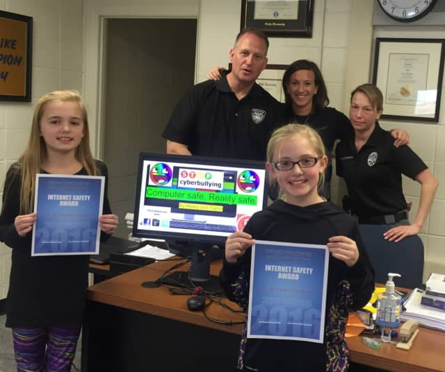 Taylor (left) and Hailey Nicholson won a contest for their presentation on Internet safety.