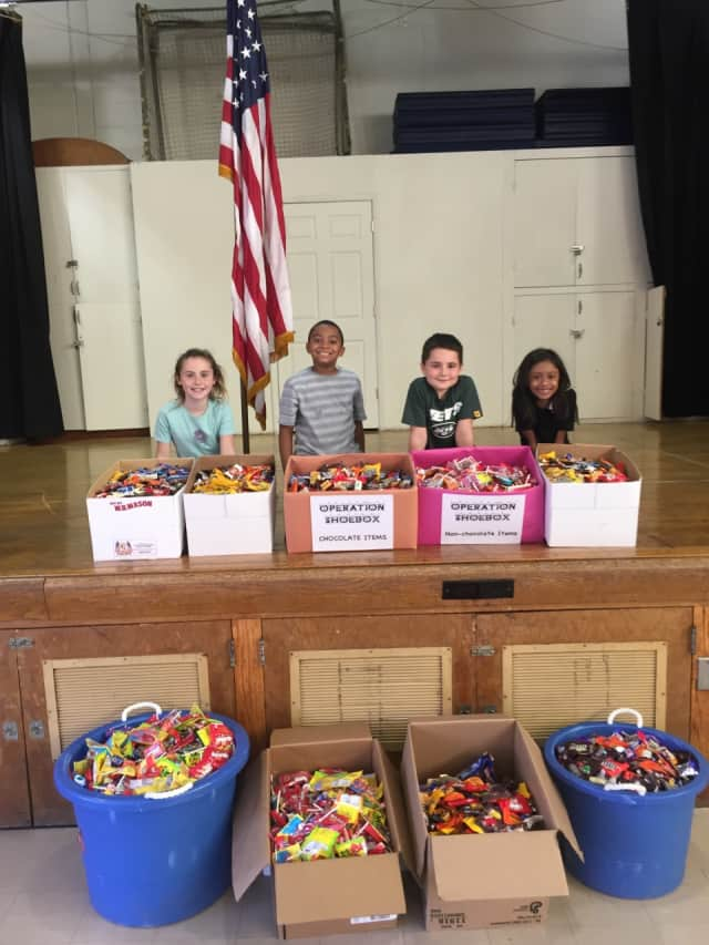George School's student volunteers with their 250-pound candy donation to the troops are, from left, Kate Churchill, Jaeden Lewis, Massimo Barrese, and Raya Lodi.