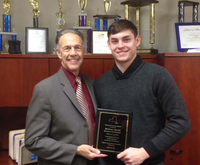 Zach Evens is shown with Director of Health, Physical Education and Athletics, Stewart Hanson at Harrison High School.