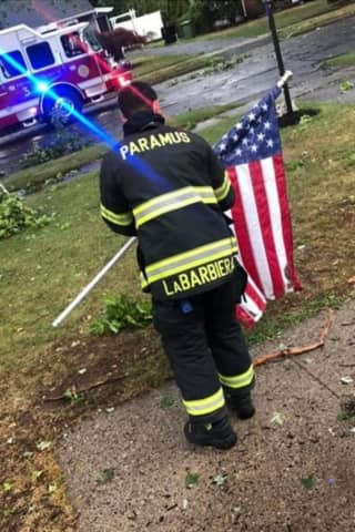 Resident: Paramus Firefighter Raises Fallen Stars And Stripes During Storm