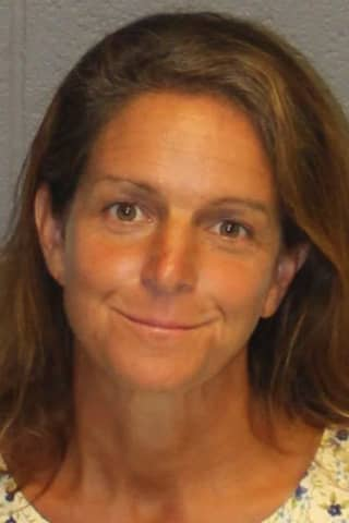 Woman, Man Accused Of Running Counterfeit CT, NY Scheme Involving Car Titles, Insurance Cards