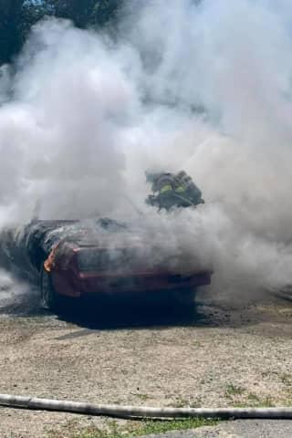 PHOTOS: Warren County Crews Douse Fully Engulfed Car Fire