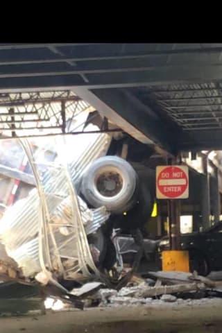 Dump Truck Crashes Through North Bergen Parking Garage