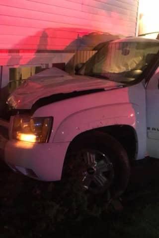 Photos: Pickup Truck Severs Utility Pole, Crashes Into Monroe House