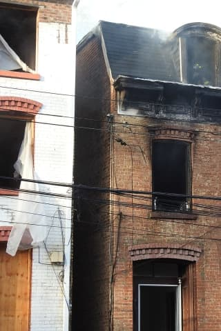 Police Officer Rescues Man Trapped On Roof During Apartment Fire In Area