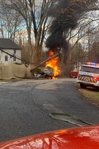 Car Bursts Into Flames After Crashing Into Pole In Westchester