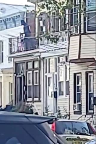 Officer Catches Infant Who Man Dangled Off Balcony For 2 Hours In Jersey City (VIDEO)