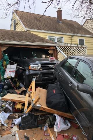 Truck Knocks Sedan Through Rear Of Little Ferry Garage